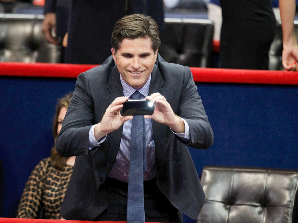 Tagg Romney takes a picture from the VIP box during second session of the Republican National Convention in Tampa