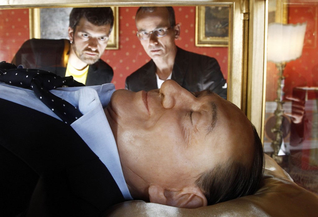 "RNPS IMAGES OF THE YEAR 2012 - Italian artists Antonio Garullo (R) and Mario Ottocento (L) look at their exhibit entitled ""The Dream Of Italian"", which comprises of a wax figurine representing Italy's former prime minister Silvio Berlusconi as being dead, at the Ferrajoli Palace in downtown Rome May 29, 2012. REUTERS/Alessandro Bianchi (ITALY - Tags: SOCIETY TPX IMAGES OF THE DAY)"