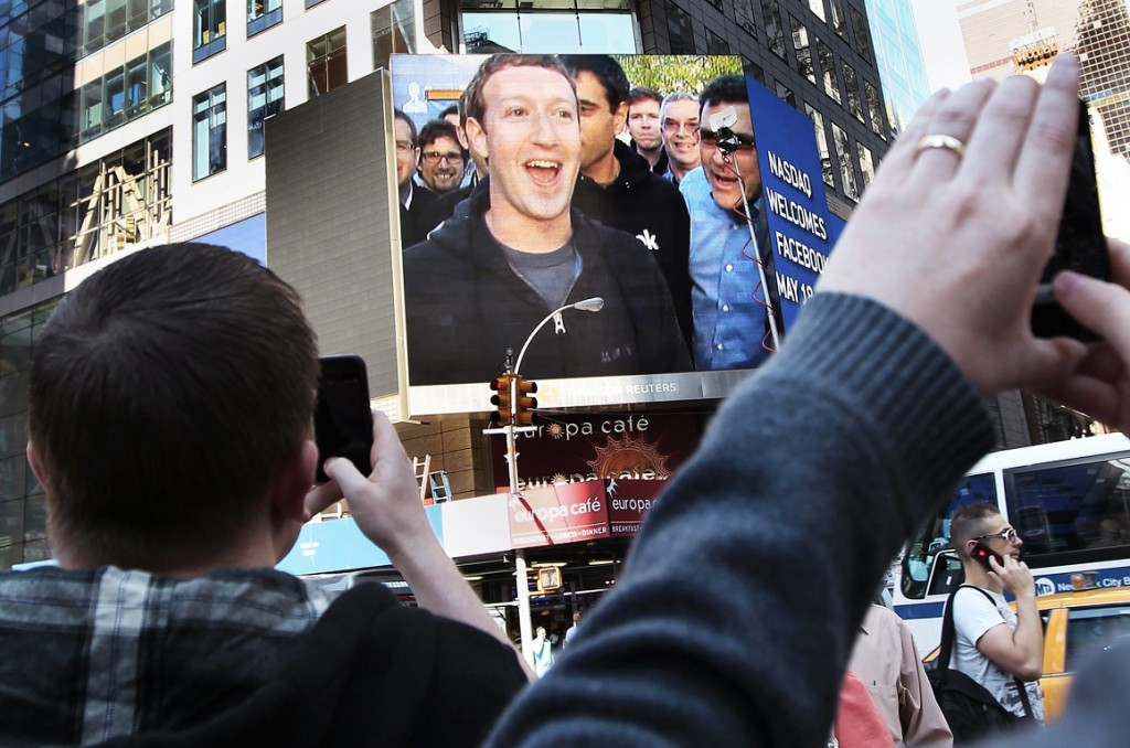 acebook Inc. CEO Mark Zuckerberg is seen on a screen televised from their headquarters in Menlo Park moments after their IPO launch in New York in this May 18, 2012 file photograph. Roughly 800 million additional shares of Facebook stock were eligible to begin trading on Wednesday, after restrictions on insider selling were lifted on the biggest block of shares since the company's May IPO. REUTERS/Shannon Stapleton/Files (UNITED STATES - T