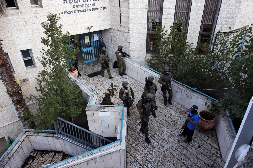 Israeli security personnel  search a religious Jewish Yeshiva next to a synagogue, where a suspected Palestinian attack took place, in Jerusalem,