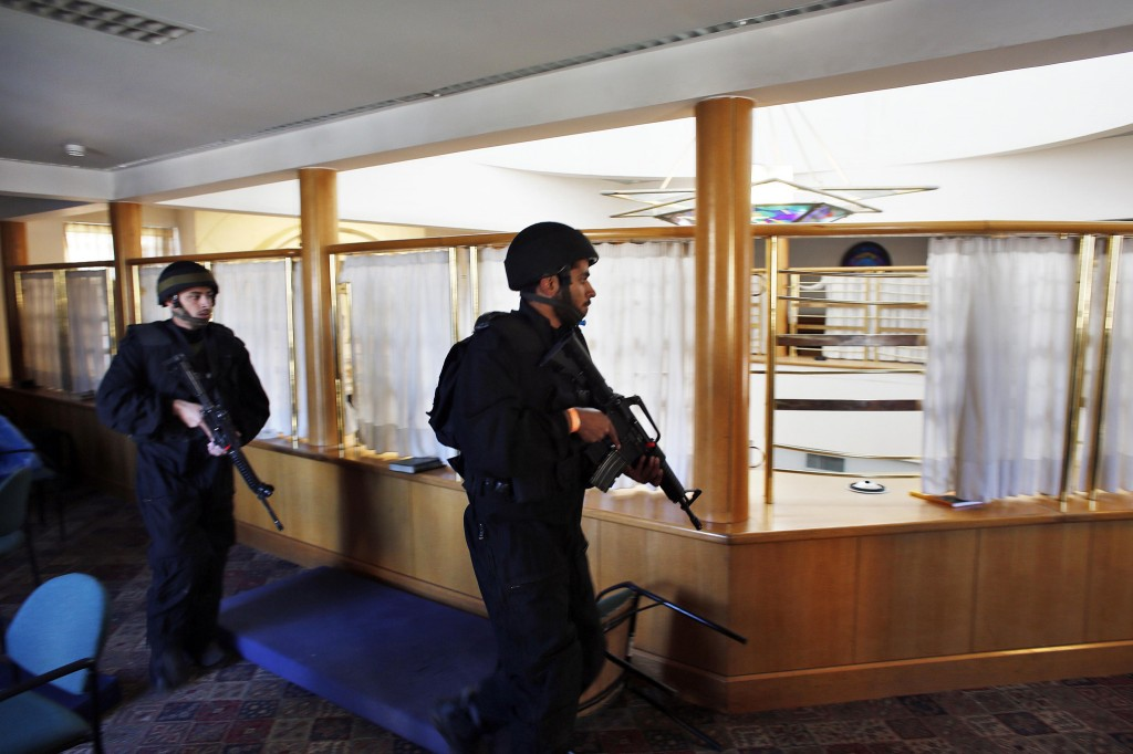 Israeli security personnel search a religious Jewish Yeshiva next to a synagogue, where a suspected Palestinian attack took place, in Jerusalem